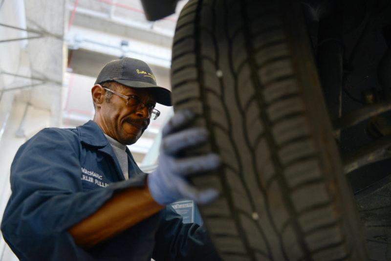 mechanic-working-on-a-tire